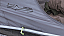 Cable entry point on inner tent to charge devices in the bedroom
