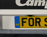 Sticky pad to attach number plate