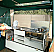 Luxury trailer tent kitchen with double burner, grill, sink and cupboard storage space