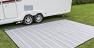 Breathable carpet allows grass to grow