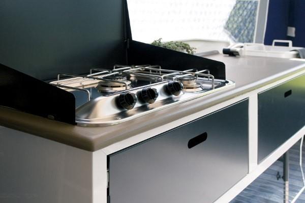 Standard kitchen has sink, water, cupboard and worktop